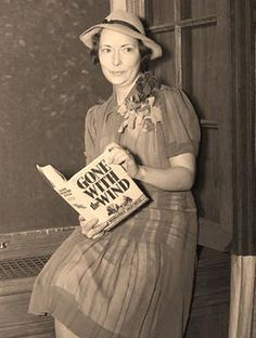 Gone With the Wind author Margaret Mitchell holds a copy of her best-selling novel during her first New York interview at her publishers' office in Margaret Mitchell, I Love Books, Great Books, My Books, People Reading, Atlanta, Scorpio Woman, Writers And Poets, Gone With The Wind