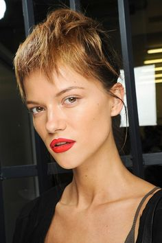 Hair: Guido Palau Spring/Summer 2013 Ponytails, flipped back on themselves to create faux fringes, at Prada. Photo By GoRunway