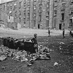 Child playing in tenement courtyard Maryhill Glasgow 1971