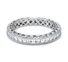 Platinum and diamond straight eternity band, pictured with square channel-set diamonds around the band. Round pave-set diamonds accent the crescent silhouette details.