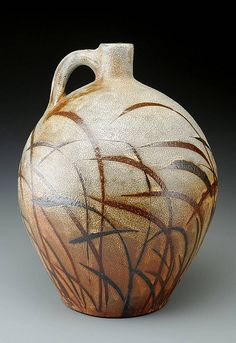 This is a woodfired Jug made by Michael Kline of Bakersville, NC. Michael Kline is known for his floral brush patterns that gracefully wraps around his wood fired pottery forms. www.michaelklinepottery.blogspot.com  Come and enjoy his work at:  Cousins in Clay A Sale of Contemporary Ceramic Art in Seagrove, NC June 5 and 6, 2010 Sat, 9-4 and Sun 10-4 www.cousinsinclay.com  A kinship based on shared appreciation for the pursuit of excellence within the diverse language of clay.