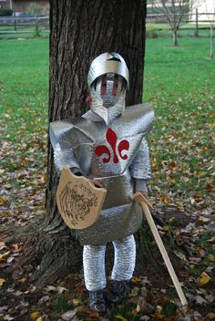 He LOVEs this idea. Looks cheap and fairly easy to make! Yay! http://savingslifestyle.com/2011/10/homemade-knight-shining-armor-costume/