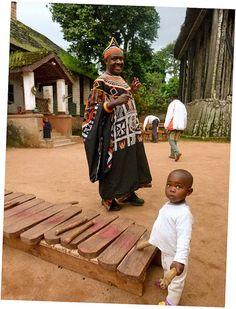 His Majesty Abumbi II of Bafut and his daughter, Cameroon.  Photo:  ToSStudio, via Flickr