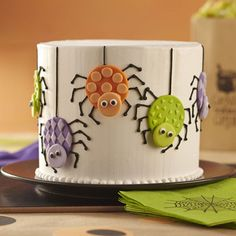 Easily make colorful fondant spiders using Wilton White Decorator Preferred Fondant and Round Double Cut-Outs Set. The creepy-crawlies decorate the side of a cake that?s perfect to serve at a Halloween party.
