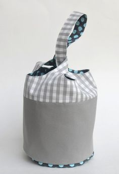 Bucket tote tutorial. Slip through handle is a quick and easy closure for kids (or anyone) to negotiate. Circular tote is stable and accommodates carrying odd shaped items. The author has pics of lots of variations of totes and bags on her site.