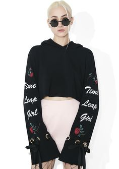 one spo Time Leap Girl Cropped Flare Hoodie would chase ya through multiple universes 'N parallel worlds. Get ready to jump up in this dope cropped hoodie, featurin' a black construction, extra long flared sleeves studded with grommets, tie closures, and delicate embroidery down each arm of roses and cursive text reading 'Time Leap Girl.'