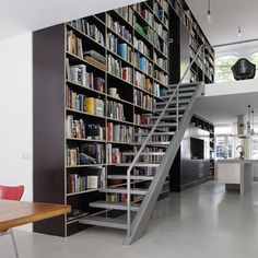 Cool use of a shelf going through multiple stories; grounding the stairwell and overall space.