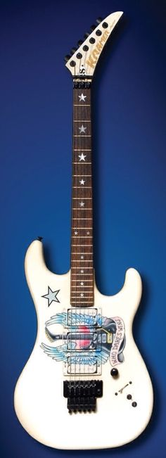 "KRAMER | Richie Sambora ""Who Dares Wins"" Custom Guitar •Designed by Richie Sambora, this custom-painted KRAMER features his signature star inlays and ""Who Dares Wins"" motif. Cherished by Sambora, he bares a tattoo of stage with Bon Jovi throughout the early '90s."
