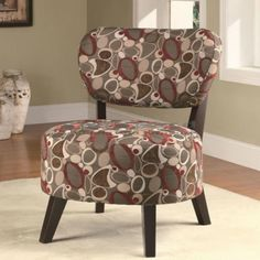 Accent Chair with Oblong Abstract Print 900425 Spice up any room in your home with this attractive accent chair. The piece carries multiple patterns and features dark brown wood legs for a clean, contemporary look. There will be lots to like with this accent chair in your home. Take a look at this accent chair with its unique oblong patterns in a blend of cream, burgundies, and brown colors. Perfect accent chair to match with to espresso or brown furniture and upholstery.
