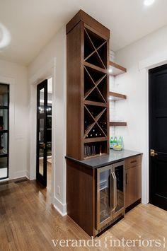 Veranda Interiors: Great wet bar/butlers pantry area. Stainless steel mini bar, chocolate brown wood ...