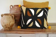 African Mud cloth Mali pillow. Black,beige and tan.. $35.00, via Etsy.