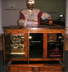 """The Turk"" is a chess-playing automaton, dating to the late 1700s. This mechanical chess player beat many opponents, but eventaully it was discovered that it was a hoax -- a small person was hidden inside the contraption moving the arm and, thus, the chess pieces."