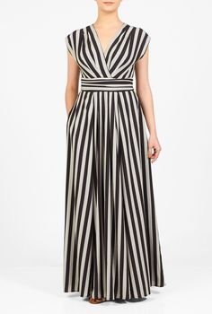 Our graphic stripe print maxi dress is cut at floor length with a flirty surplice V-neck. The banded Empire waist and box pleating at the bodice and waist add feminine detail.