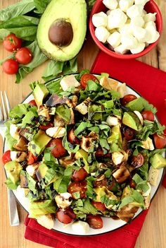 Avocado and Chicken Caprese Salad Ingredients:  Romaine lettuce Cherry tomatoes, halved Avocado, chopped Fresh mozzarella, chopped Chicken breasts, chopped (I used garlic salt & pepper-seasoned, sauteed chicken breasts) Fresh torn basil Balsamic reduction