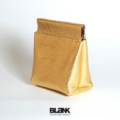 Hand stitched Gold Leather Pinch Squeeze Frame Coins Purse. $34.99, via Etsy.