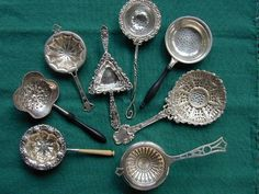 A Collection of Vintage Silver Tea Strainers ....