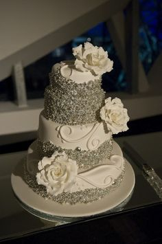 White and Silver wedding cake... tone down some of the silver and perfect!