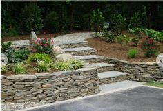 Fieldstone seating wall and stairs by gdiva.com