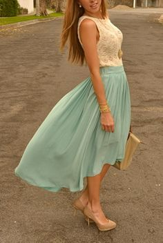 Mint or light blue flowy maxi skirt with cream lace tank and nude heels. cute outfit even though the windy bendy pic is a little weird.