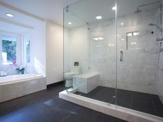 The master suite includes this luxurious, spa-like bath with oversized glass-enclosed shower and extra large tub.