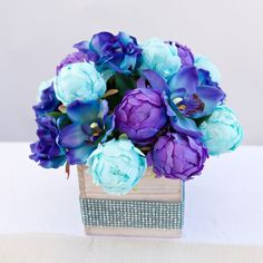 Create this beautiful peony and orchid centerpiece. With high-quality silk flowers and container from Afloral.com, this DIY is simple, easy and so pretty for an