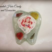 resin tooth shaped box lightweight, durable can fit one tooth or a few. You can have one make for every tooth! Ariel The Little Mermaid real sea shells  Message me for a custom order request and we can talk over all the details before making it final.  Facebook: www.facebook.com/hauntedha...