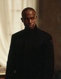 Thaumaturge Aimery (but he wears red) (actor Taye Diggs)
