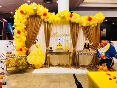Beauty and the beast balloon arch