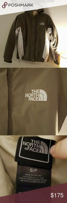 The north face ski jacket A very warm winter ski coat. My husband bought it for me a couple winters back. I have hardly worn it! Still in great condition, besides the tiny hole in the inside liner I've never noticed it before listing this. There is a separate jacket that comes out shown in pictures. Very cute !! The color is a mix of tan and grey The North Face Jackets & Coats
