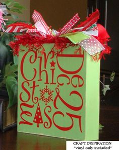 Christmas vinyl lettering applied to a painted wood block. See more designs and ideas at www.lacybella.com
