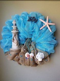 Unique Ways to Use Lighthouses for Decor – Beach Bliss Living Don't you just love seeing lighthouses standing tall, pounded by waves and buffeted by winds, but still shining their light across the sea? Some of the most breathtaking scenery along the Deco Mesh Garland, Deco Mesh Wreaths, Yarn Wreaths, Floral Wreaths, Burlap Wreaths, Mesh Wreath Tutorial, Diy Wreath, Wreath Ideas, Tulle Wreath