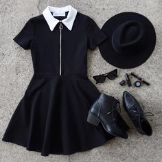 All black #ootd in the NEW Addams Zip-Up Mini Dress