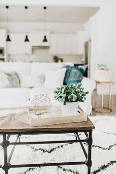 Like colors - white, black, wood, green accents.  Looks comfortable and inviting.