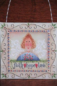 I love this little garden angel! She is painted on the cutest tin tile with a hanger and a stand for tabletop display!