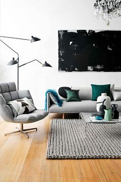 Modern living room with a gray sofa and matching shag rug.  #currentlycoveting #holidays2015 #holidaze #holidaystyle
