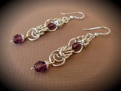 Hey, I found this really awesome Etsy listing at https://www.etsy.com/listing/158795539/chainmaille-earrings-with-wire-wrapped