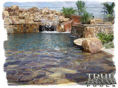 http://poolsbytrueblue.com/gallery/pools/flagstone-beach-pool.jpg