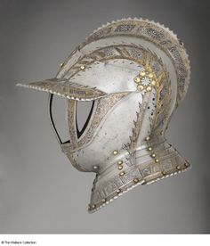 Close-helmet Attributed to Wolfgang Grosschedel (1517 - 1562) Germany, probably Landshut c. 1550 - c. 1560 Iron or steel and copper alloy, etched, gilt and blackened Weight: 3.265 kg