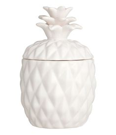 White/pineapple. Candle in a pineapple-shaped ceramic holder with lid…