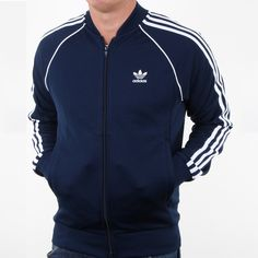 We stock many great styles of adidas clothing including this stunning adidas Superstar in Navy. Available in sizes on offer from Be sure to check out more tracktsuits through the link to our website. Tracksuit Jacket, Tracksuit Tops, Adidas Jacket, Adidas Superstar Tracksuit, Sports Tracksuits, Adidas Clothing, Men's Clothing, Adidas Outfit, Navy And White