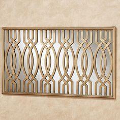 Curving strips of satin gold metal overlap and weave across the reflective surface of the Byanca Mirrored Wall Art for a captivating display. Gold Wall Decor, Metal Wall Decor, Metal Wall Art, Balcony Grill Design, Window Grill Design, Mirror Panels, Mirror Wall Art, Mirrors, Iron Gate Design