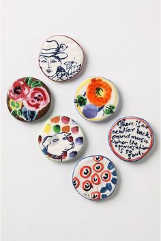 """Moment's Magnets.  Display your memories beneath the sketchbook scenes of these artsy ceramic magnets.  Set of six.  Stoneware.  2"""" diameter.   #20846937  $32.00  color:MULTI http://www.anthropologie.com/anthro/catalog/productdetail.jsp?id=20846937&catId=HOME-KITCHEN&pushId=HOME-KITCHEN&popId=HOME&navAction=top&navCount=1776&color=095&isProduct=true&fromCategoryPage=true&subCategoryId=HOME-KITCHEN-GADGETS"""