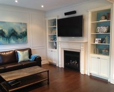 Tv Over Fireplace Design Ideas, Pictures, Remodel, and Decor - page 70 Like painted wall behind bookcase.