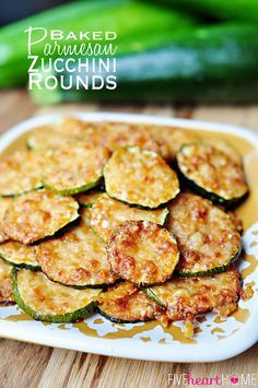 "Ing: 2 medium zucchinis 1/2 cup freshly grated Parmesan cheese Garlic salt & ground black pepper, optional Direct: Preheat oven to 425°F. Line baking sheet with foil (lightly misted w/ cooking spray). Cut zucchini into 1/4"" thick slices. Arrange zucchini on pan. Sprinkle w/ garlic salt & freshly ground black pepper-optional Spread a thin layer of Parmesan on each. Bake 15-20 min or til Parm. turns a light gldn brown. (Pull out of oven early if Parmesan is golden before 15 min) Serve…"