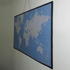 This map is not much use for planning your holiday but it is fun to have hanging on the wall. When you look straight at the knitting you see only stripes. When you move to the side the map magically appears.
