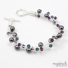 Lovely wire crochet bracelet with glam evening look. The color combination is dark grey, purple, blue & silver. MEMBER - MagsBead Creation