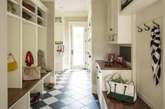 Traditional Mud Room with limestone tile floors, High ceiling, Built-in bookshelf