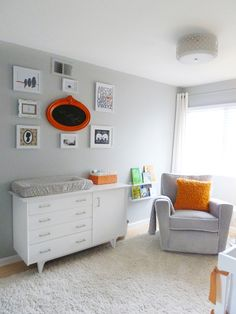 Neutral nursery with pops of orange! #nurserydecor #gallerywall
