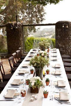 Vineyard wedding style, terra cotta pots with succulents, white linen