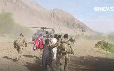"""Australian SAS photographed while holding up a Confederate flag on a mission in 2012 in Uruzgan Province Afghanistan. The flag reads: """"Southern Pride"""". In a video, an Australian soldier is seen slinging the flag over his shoulder while escorting bound Afghan men to a Black Hawk. Bush Jr, Colorado College, Armed Conflict, Southern Pride, Military News, Pop Culture References, Black Hawk, Confederate Flag, Islamic World"""